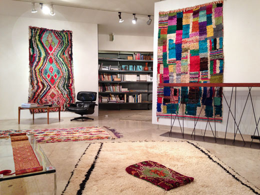 boucherouite rag rugs on the wall, an unusual Beni Ouarain rug + a Boujad pillow on the floor