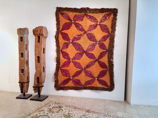 Afghan felt rug + indonesian buffallo fence wood posts