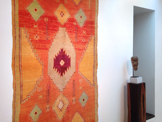 an unusual Ait Ouaouzguite rug, Jebel Siroua, southern Morocco + a deformation mask from the Igbo people, Nigeria