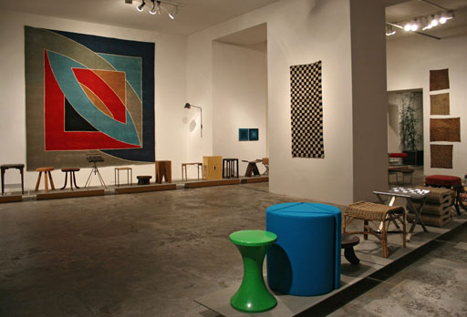 geometrien exhibition vienna. vintage Frank Stella carpet + Tibetan checkerboard rug